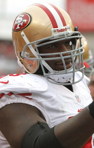 Dec 15, 2013; Tampa, FL, USA; San Francisco 49ers nose tackle Glenn Dorsey (90) against the Tampa Bay Buccaneers during the second half at Raymond James Stadium. San Francisco 49ers defeated the Tampa Bay Buccaneers 33-14. Mandatory Credit: Kim Klement-USA TODAY Sports