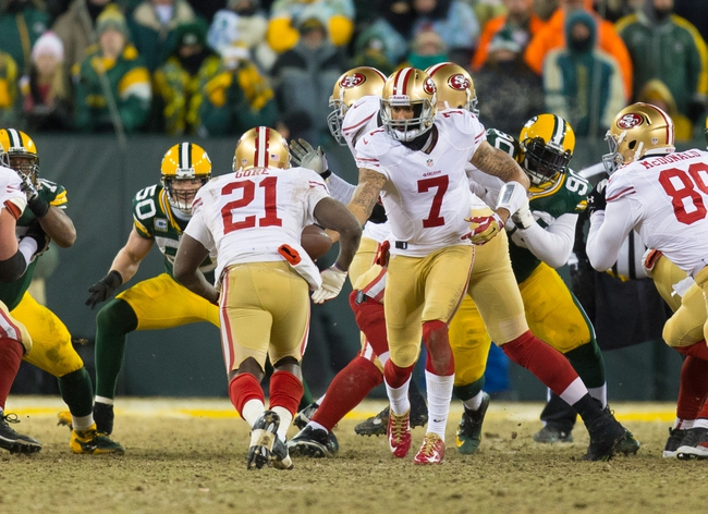 Jan 5, 2014; Green Bay, WI, USA; San Francisco 49ers quarterback Colin Kaepernick (7) hands off to running back Frank Gore (21) during the 2013 NFC wild card playoff football game against the Green Bay Packers at Lambeau Field.  San Francisco won 23-20.  Mandatory Credit: Jeff Hanisch-USA TODAY Sports