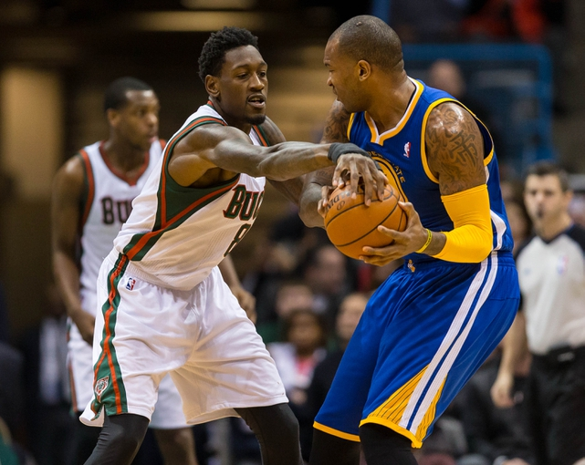 Jan 7, 2014; Milwaukee, WI, USA; Milwaukee Bucks center Larry Sanders (8) defends during the game against the Golden State Warriors at BMO Harris Bradley Center.  Golden State won 101-80.  Mandatory Credit: Jeff Hanisch-USA TODAY Sports