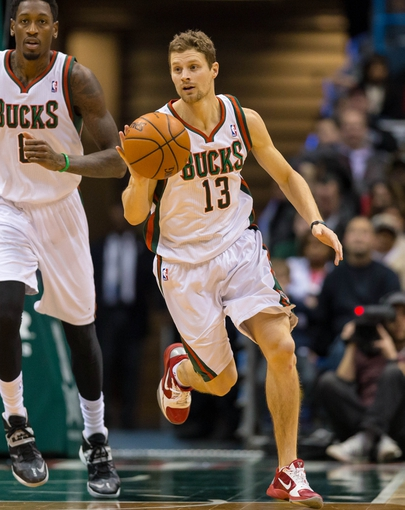Jan 7, 2014; Milwaukee, WI, USA; Milwaukee Bucks guard Luke Ridnour (13) during the game against the Golden State Warriors at BMO Harris Bradley Center.  Golden State won 101-80.  Mandatory Credit: Jeff Hanisch-USA TODAY Sports