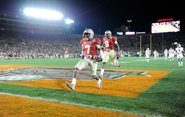 Jan 6, 2014; Pasadena, CA, USA; Florida State Seminoles receiver Levonte Whitfield (7) celebrates with running back Karlos Williams (9) after scoring on a 100-yard kickoff return against the Auburn Tigers in the fourth quarter of the 2014 BCS National Championship game at the Rose Bowl.  Mandatory Credit: Kirby Lee-USA TODAY Sports