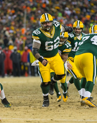 Jan 5, 2014; Green Bay, WI, USA; Green Bay Packers center Evan Dietrich-Smith (62) during the 2013 NFC wild card playoff football game against the San Francisco 49ers at Lambeau Field.  San Francisco won 23-20.  Mandatory Credit: Jeff Hanisch-USA TODAY Sports