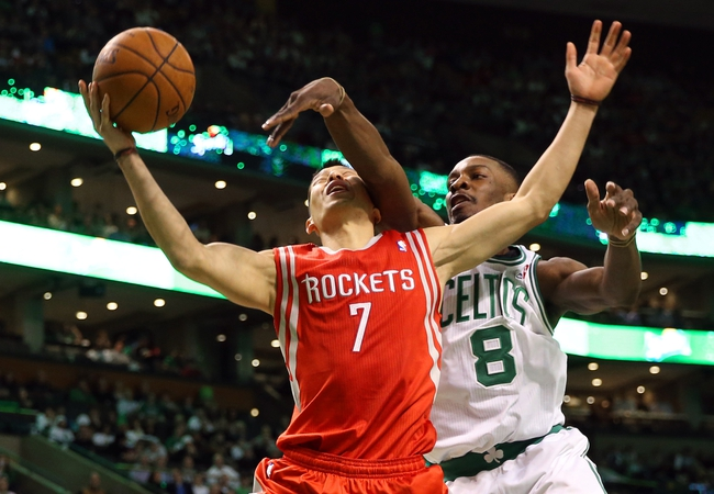 Jan 13, 2014; Boston, MA, USA; Houston Rockets point guard Jeremy Lin (7) gets fouled by Boston Celtics small forward Jeff Green (8) during the first quarter at TD Garden. Mandatory Credit: Winslow Townson-USA TODAY Sports