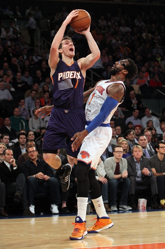 Jan 13, 2014; New York, NY, USA; Phoenix Suns shooting guard Goran Dragic (1) shoots over New York Knicks power forward Amar'e Stoudemire (1) during the first quarter of a game at Madison Square Garden. Mandatory Credit: Brad Penner-USA TODAY Sports