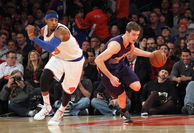 Jan 13, 2014; New York, NY, USA; Phoenix Suns shooting guard Goran Dragic (1) controls the ball against New York Knicks shooting guard Toure' Murry (23) during the second quarter of a game at Madison Square Garden. Mandatory Credit: Brad Penner-USA TODAY Sports