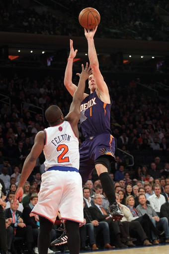 Jan 13, 2014; New York, NY, USA; Phoenix Suns shooting guard Goran Dragic (1) shoots over New York Knicks point guard Raymond Felton (2) during the second quarter of a game at Madison Square Garden. Mandatory Credit: Brad Penner-USA TODAY Sports