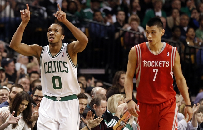 Jan 13, 2014; Boston, MA, USA; Boston Celtics point guard Avery Bradley (0) celebrates after a three pointer next to Houston Rockets point guard Jeremy Lin (7) during the first quarter at TD Garden. Mandatory Credit: Winslow Townson-USA TODAY Sports
