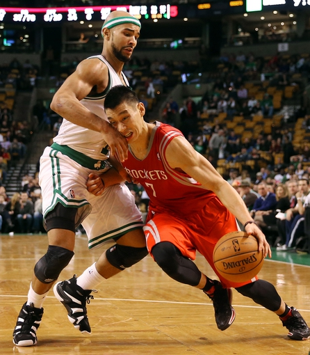 Jan 13, 2014; Boston, MA, USA; Houston Rockets point guard Jeremy Lin (7) drives on Boston Celtics point guard Jerryd Bayless (11) during the second half of Houston's 104-92 win  at TD Garden. Mandatory Credit: Winslow Townson-USA TODAY Sports