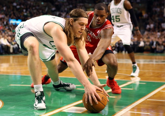 Jan 13, 2014; Boston, MA, USA; Boston Celtics center Kelly Olynyk (41) grabs a loose ball away from Houston Rockets power forward Terrence Jones (6) during the second half of Houston's 104-92 win  at TD Garden. Mandatory Credit: Winslow Townson-USA TODAY Sports