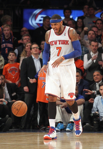 Jan 13, 2014; New York, NY, USA; New York Knicks small forward Carmelo Anthony (7) reacts during overtime of a game against the Phoenix Suns at Madison Square Garden. The Knicks defeated the Suns 98-96 in overtime. Mandatory Credit: Brad Penner-USA TODAY Sports