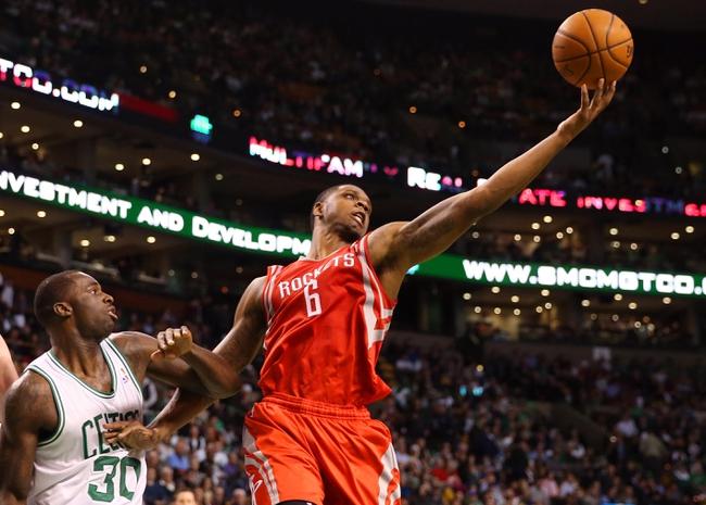 Jan 13, 2014; Boston, MA, USA; Houston Rockets power forward Terrence Jones (6) grabs a rebound over Boston Celtics power forward Brandon Bass (30) during the second half of Houston's 104-92 win  at TD Garden. Mandatory Credit: Winslow Townson-USA TODAY Sports