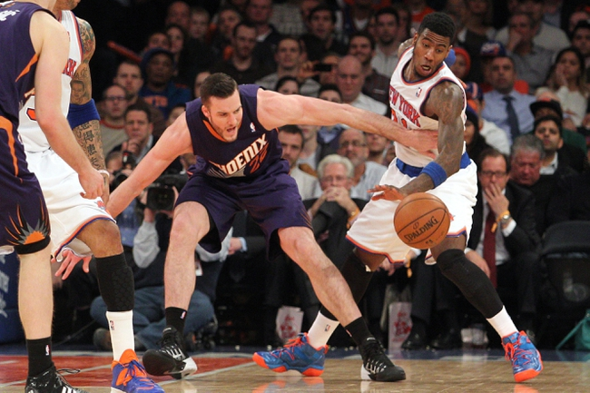 Jan 13, 2014; New York, NY, USA; New York Knicks shooting guard Iman Shumpert (21) steals the ball from Phoenix Suns center Miles Plumlee (22) during the fourth quarter of a game at Madison Square Garden. The Knicks defeated the Suns 98-96 in overtime. Mandatory Credit: Brad Penner-USA TODAY Sports