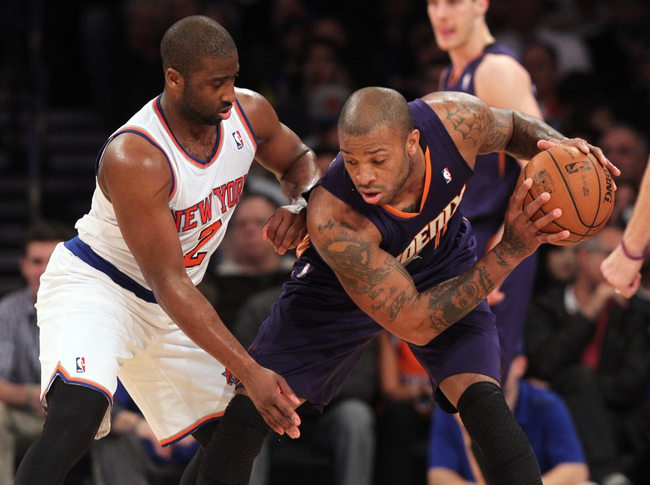 Jan 13, 2014; New York, NY, USA; Phoenix Suns small forward P.J. Tucker (17) controls the ball against New York Knicks point guard Raymond Felton (2) during the third quarter of a game at Madison Square Garden. The Knicks defeated the Suns 98-96 in overtime. Mandatory Credit: Brad Penner-USA TODAY Sports