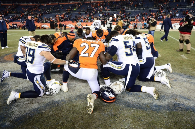 Dec 12, 2013; Denver, CO, USA; Members of the San Diego Chargers and the Denver Broncos huddle in prayer following the game at Sports Authority Field at Mile High. The San Diego Chargers defeated the Denver Broncos 27-20. Mandatory Credit: Ron Chenoy-USA TODAY Sports