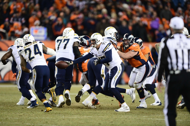 Dec 12, 2013; Denver, CO, USA; San Diego Chargers quarterback Philip Rivers (17) attempts to hand off to San Diego Chargers running back Ryan Mathews (24)  in the fourth quarter against the Denver Broncos at Sports Authority Field at Mile High. The San Diego Chargers defeated the Denver Broncos 27-20. Mandatory Credit: Ron Chenoy-USA TODAY Sports
