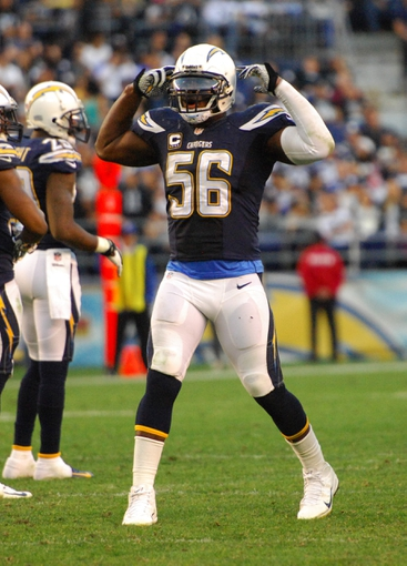 Dec 22, 2013; San Diego, CA, USA; San Diego Chargers linebacker Donald Butler (56) celebrates during the game against the Oakland Raiders at Qualcomm Stadium. The Chargers won 26-13.Mandatory Credit: Kirby Lee-USA TODAY Sports