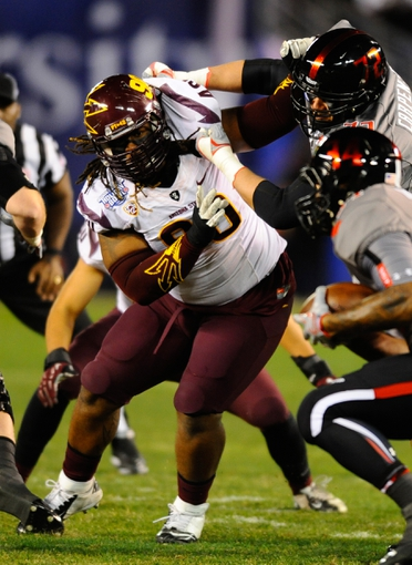Dec 30, 2013; San Diego, CA, USA; Arizona State Sun Devils defensive tackle Will Sutton (90) is blocked during the first half against the Texas Tech Red Raiders during the first half in the Holiday Bowl at Qualcomm Stadium. Mandatory Credit: Christopher Hanewinckel-USA TODAY Sports