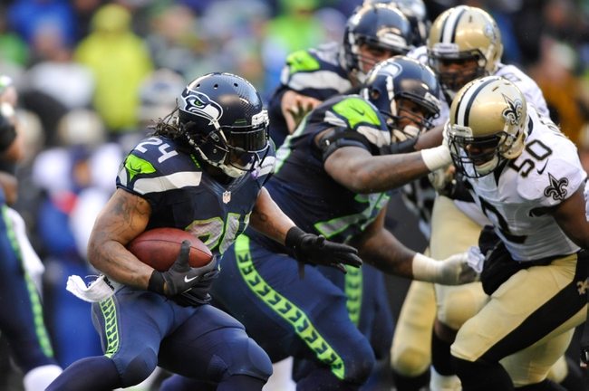 Jan 11, 2014; Seattle, WA, USA; Seattle Seahawks running back Marshawn Lynch (24) carries the ball against the New Orleans Saints during the second half of the 2013 NFC divisional playoff football game at CenturyLink Field. Seattle defeated New Orleans 23-15. Mandatory Credit: Steven Bisig-USA TODAY Sports