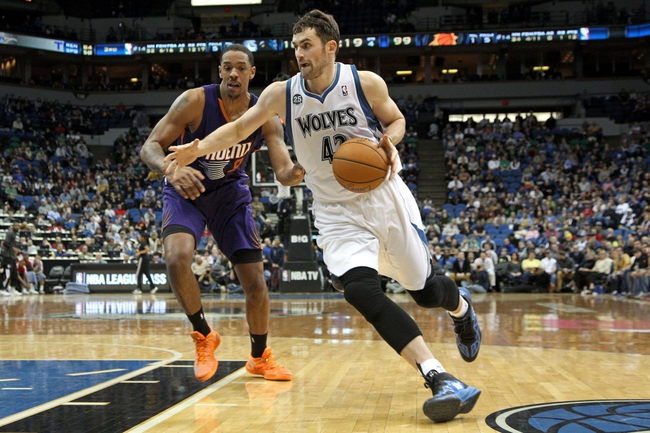 Jan 8, 2014; Minneapolis, MN, USA; Minnesota Timberwolves forward Kevin Love (42) against the Phoenix Suns at Target Center. The Suns defeated the Timberwolves 104-103. Mandatory Credit: Brace Hemmelgarn-USA TODAY Sports