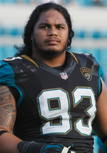 Dec 22, 2013; Jacksonville, FL, USA; Jacksonville Jaguars defensive end Tyson Alualu (93) against the Tennessee Titans during the second half at EverBank Field. Tennessee Titans defeated the Jacksonville Jaguars 20-16.  Mandatory Credit: Kim Klement-USA TODAY Sports