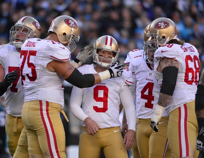 Jan 12, 2014; Charlotte, NC, USA; San Francisco 49ers guard Alex Boone (75) and kicker Phil Dawson (9) and punter Andy Lee (4) and guard Adam Snyder (68) react during the fourth quarter of the 2013 NFC divisional playoff football game at Bank of America Stadium. San Francisco won 23-10. Mandatory Credit: Bob Donnan-USA TODAY Sports