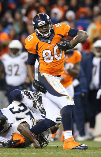 Jan 12, 2014; Denver, CO, USA; Denver Broncos receiver Julius Thomas (80) runs after a reception against the San Diego Chargers during the 2013 AFC divisional playoff football game at Sports Authority Field at Mile High. Mandatory Credit: Matthew Emmons-USA TODAY Sports