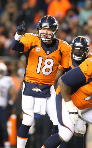 Jan 12, 2014; Denver, CO, USA; Denver Broncos quarterback Peyton Manning (18) signals prior to the snap against the San Diego Chargers during the 2013 AFC divisional playoff football game at Sports Authority Field at Mile High. Mandatory Credit: Matthew Emmons-USA TODAY Sports