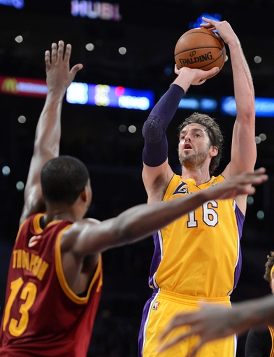 Jan 14, 2014; Los Angeles, CA, USA; Cleveland Cavaliers power forward Tristan Thompson (13) guards Los Angeles Lakers center Pau Gasol (16) in the second half of the game at Staples Center. Cleveland Cavaliers won 120-118. Mandatory Credit: Jayne Kamin-Oncea-USA TODAY Sports
