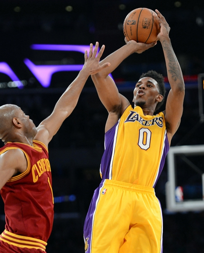 Jan 14, 2014; Los Angeles, CA, USA; Cleveland Cavaliers point guard Jarrett Jack (1) guards Los Angeles Lakers small forward Nick Young (0) in the second half of the game at Staples Center. Cleveland Cavaliers won 120-118. Mandatory Credit: Jayne Kamin-Oncea-USA TODAY Sports