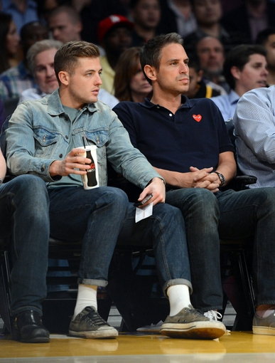 Jan 14, 2014; Los Angeles, CA, USA;  L.A. Galaxy player Robbie Rogers (left) and producer Greg Berlanti watch the game between the Los Angeles Lakers and the Cleveland Cavaliers at Staples Center. Cleveland Cavaliers won 120-118. Mandatory Credit: Jayne Kamin-Oncea-USA TODAY Sports
