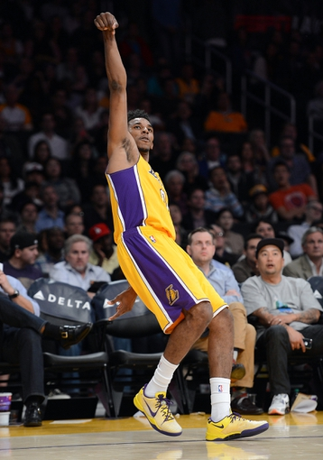 Jan 14, 2014; Los Angeles, CA, USA; Los Angeles Lakers small forward Nick Young (0) shoots in the second half of the game against the Cleveland Cavaliers at Staples Center. Cleveland Cavaliers won 120-118. Mandatory Credit: Jayne Kamin-Oncea-USA TODAY Sports
