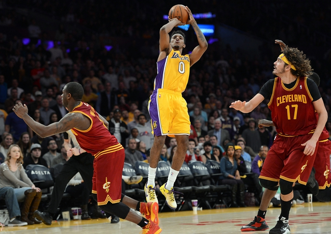 Jan 14, 2014; Los Angeles, CA, USA; Cleveland Cavaliers center Anderson Varejao (17) looks on as Los Angeles Lakers small forward Nick Young (0) goes for a last second shot in the fourth quarter of the game at Staples Center. Cleveland Cavaliers won 120-118. Mandatory Credit: Jayne Kamin-Oncea-USA TODAY Sports