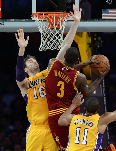 Jan 14, 2014; Los Angeles, CA, USA; Los Angeles Lakers shooting guard Wesley Johnson (11) and center Pau Gasol (16) defend Cleveland Cavaliers shooting guard Dion Waiters (3) in the second half of the game at Staples Center. Cleveland Cavaliers won 120-118. Mandatory Credit: Jayne Kamin-Oncea-USA TODAY Sports