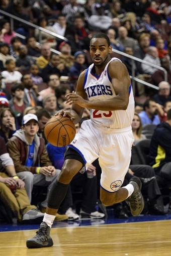 Jan 6, 2014; Philadelphia, PA, USA; Philadelphia 76ers guard Elliot Williams (25) dribbles the ball during the fourth quarter against the Minnesota Timberwolves at the Wells Fargo Center. The Timberwolves defeated the Sixers 126-95. Mandatory Credit: Howard Smith-USA TODAY Sports