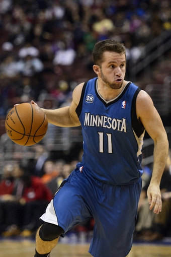 Jan 6, 2014; Philadelphia, PA, USA; Minnesota Timberwolves guard Jose Barea (11) dribbles the ball during the third quarter against the Philadelphia 76ers at the Wells Fargo Center. The Timberwolves defeated the Sixers 126-95. Mandatory Credit: Howard Smith-USA TODAY Sports