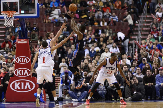 Jan 15, 2014; Philadelphia, PA, USA; Charlotte Bobcats guard Kemba Walker (15) ties the score at 92-92 late in the fourth quarter against the Philadelphia 76ers at the Wells Fargo Center. The Sixers defeated the Bobcats 95-92. Mandatory Credit: Howard Smith-USA TODAY Sports
