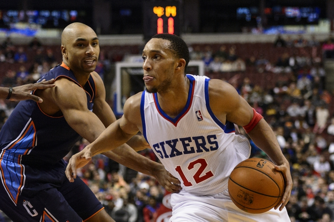Jan 15, 2014; Philadelphia, PA, USA; Philadelphia 76ers guard Evan Turner (12) is defended by Charlotte Bobcats guard Gerald Henderson (9) during the fourth quarter at the Wells Fargo Center. The Sixers defeated the Bobcats 95-92. Mandatory Credit: Howard Smith-USA TODAY Sports