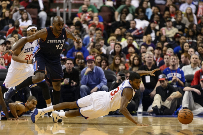 Jan 15, 2014; Philadelphia, PA, USA; Philadelphia 76ers forward Hollis Thompson (31) dives for a loose ball during the fourth quarter against the Charlotte Bobcats at the Wells Fargo Center. The Sixers defeated the Bobcats 95-92. Mandatory Credit: Howard Smith-USA TODAY Sports