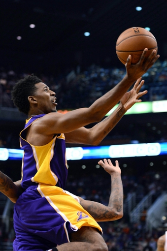 Jan 15, 2014; Phoenix, AZ, USA; Los Angeles Lakers forward Nick Young (0) lays up the ball against the Phoenix Suns in the first half at US Airways Center. Mandatory Credit: Jennifer Stewart-USA TODAY Sports