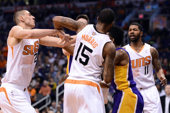 Jan 15, 2014; Phoenix, AZ, USA; Phoenix Suns center Alex Len (21) is pushed by Los Angeles Lakers forward Nick Young (0) in the first half at US Airways Center. Mandatory Credit: Jennifer Stewart-USA TODAY Sports