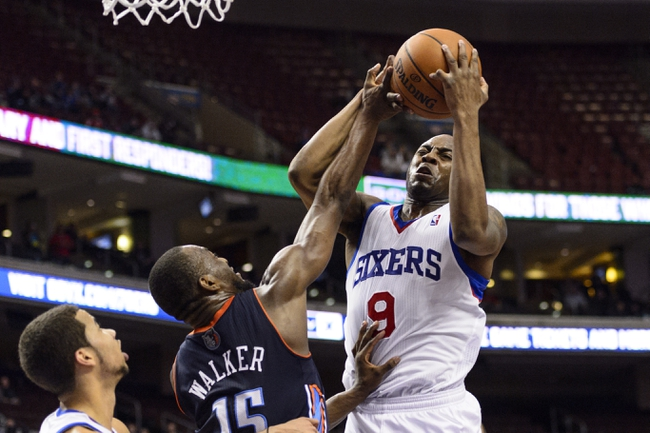 Jan 15, 2014; Philadelphia, PA, USA; Philadelphia 76ers guard James Anderson (9) fights for a rebound with Charlotte Bobcats guard Kemba Walker (15) during the fourth quarter at the Wells Fargo Center. The Sixers defeated the Bobcats 95-92. Mandatory Credit: Howard Smith-USA TODAY Sports