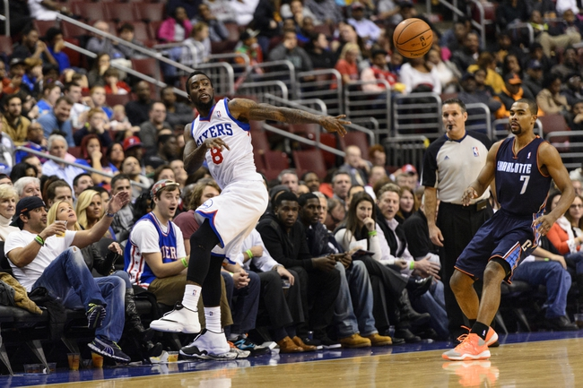 Jan 15, 2014; Philadelphia, PA, USA; Philadelphia 76ers guard Tony Wroten (8) saves a ball from going out of bounds during the fourth quarter against the Charlotte Bobcats at the Wells Fargo Center. The Sixers defeated the Bobcats 95-92. Mandatory Credit: Howard Smith-USA TODAY Sports
