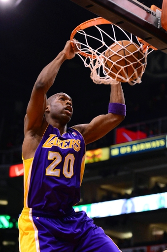 Jan 15, 2014; Phoenix, AZ, USA; Los Angeles Lakers guard Jodie Meeks (20) dunks the ball against the Phoenix Suns in the first half at US Airways Center. The Suns won 121-114. Mandatory Credit: Jennifer Stewart-USA TODAY Sports