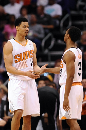 Jan 15, 2014; Phoenix, AZ, USA; Phoenix Suns guard Gerald Green (14) and guard Ish Smith (3) talk on the court in the second half of the game against the Los Angeles Lakers at US Airways Center. The Suns won 121-114. Mandatory Credit: Jennifer Stewart-USA TODAY Sports