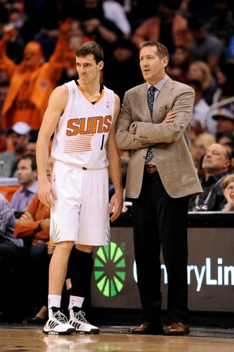 Jan 15, 2014; Phoenix, AZ, USA; Phoenix Suns guard Goran Dragic (1) talks with head coach Jeff Hornacek in the second half against the Los Angeles Lakers at US Airways Center. The Suns won 121-114. Mandatory Credit: Jennifer Stewart-USA TODAY Sports