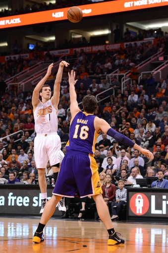 Jan 15, 2014; Phoenix, AZ, USA; Phoenix Suns guard Goran Dragic (1) shoots the ball over Los Angeles Lakers center Pau Gasol (16) in the second half at US Airways Center. The Suns won 121-114. Mandatory Credit: Jennifer Stewart-USA TODAY Sports