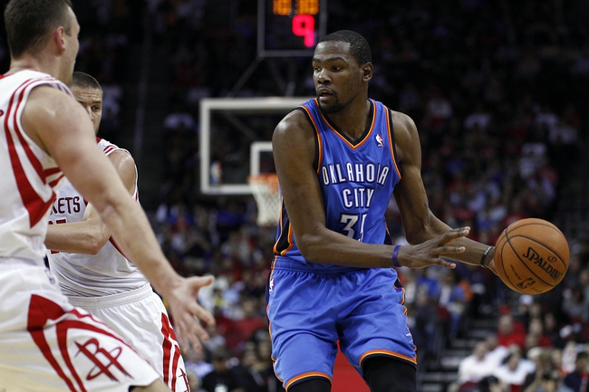 Jan 16, 2014; Houston, TX, USA; Oklahoma City Thunder small forward Kevin Durant (35) with the ball during the fourth quarter against the Houston Rockets at Toyota Center. Mandatory Credit: Andrew Richardson-USA TODAY Sports