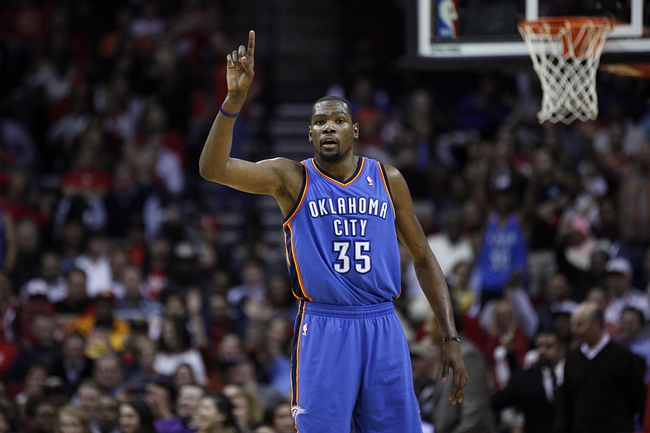 Jan 16, 2014; Houston, TX, USA; Oklahoma City Thunder small forward Kevin Durant (35) reacts to a play during the third quarter against the Houston Rockets at Toyota Center. Mandatory Credit: Andrew Richardson-USA TODAY Sports