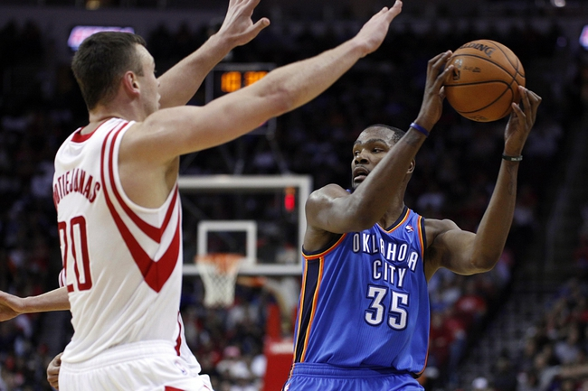 Jan 16, 2014; Houston, TX, USA; Oklahoma City Thunder small forward Kevin Durant (35) is guarded by Houston Rockets power forward Donatas Motiejunas (20) during the fourth quarter at Toyota Center. Mandatory Credit: Andrew Richardson-USA TODAY Sports