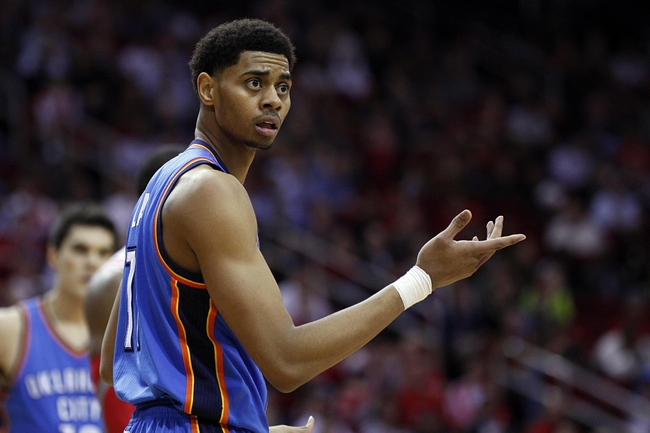 Jan 16, 2014; Houston, TX, USA; Oklahoma City Thunder shooting guard Jeremy Lamb (11) reacts to a play during the fourth quarter against the Houston Rockets at Toyota Center. Mandatory Credit: Andrew Richardson-USA TODAY Sports